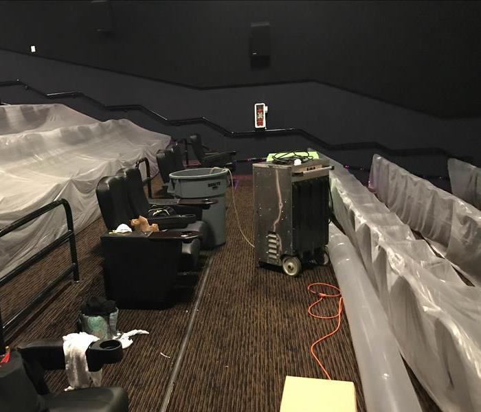 Theater with mold due to water damage has containment set up and drying equipment running
