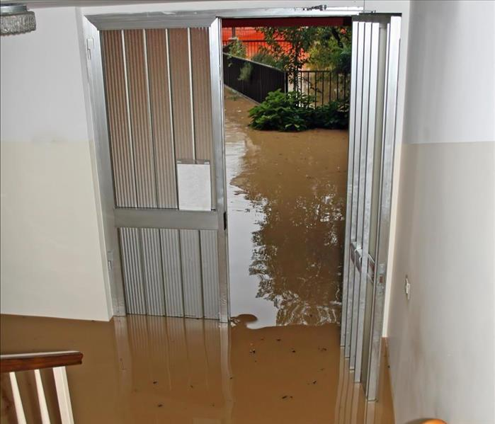 Flooded waters in the entrance of a home