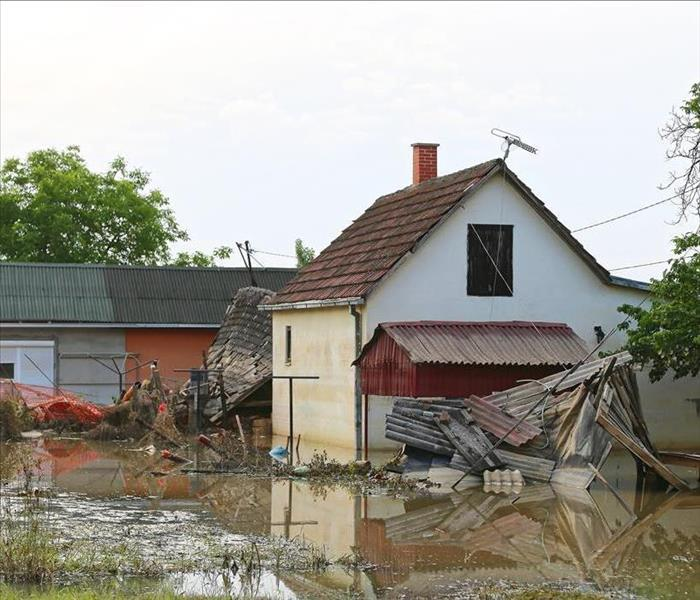 Flooded waters surrounding a house